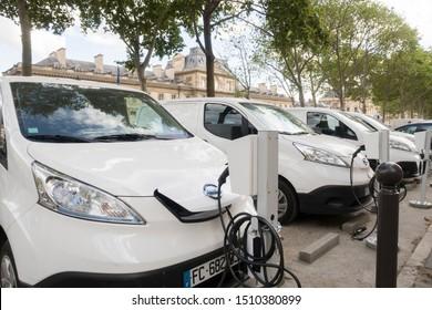 Paris, France - Sept 01, 2019: A white Nissan e-NV200 electric vans at a charging point in Paris, France