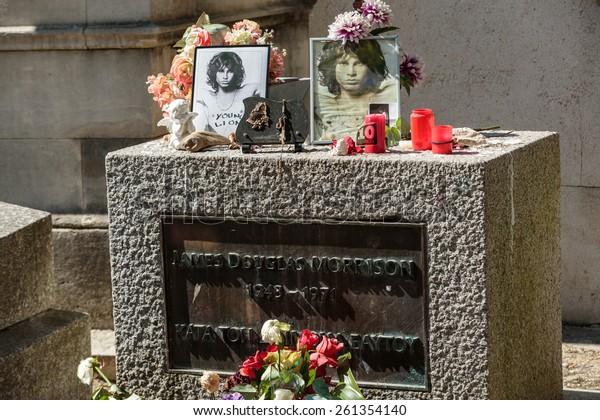 PARIS, FRANCE - SEPT 12, 2014:Jim Morrison grave in Pere-Lachaise cemetery, Paris. Each year thousands fans and curious visitors come to pay homage to Jim Morrison's grave