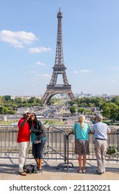 PARIS, FRANCE - SEPT 16: People is taking selfies with eiffel Tower as background on Paris, September, 16, 2014. Paris is one of the most touristic cities in the world
