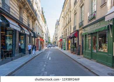 PARIS, FRANCE - SEPT. 20, 2018: People strolling and shopping in the quaint classical streets of the old town of Paris