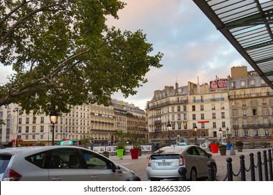Paris, France - Sept. 2020 - Taxi cars in the forecourt of Place du 11 Novembre 1918, in front of the railway station of Gare de l'Est, with high-end Haussmann apartment buildings in the background