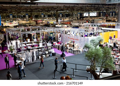 PARIS, FRANCE - SEPT; 5, 2014: People visit stands at Maison et Objet, the French leading professional trade show for home fashion and design.