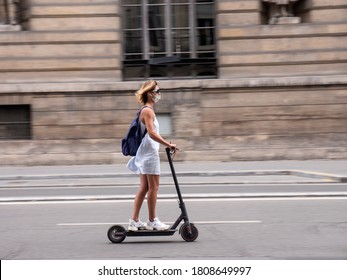PARIS, FRANCE - SEPTEMBER 03, 2020:  More people use the bike or the Electric Scooter to get around town.