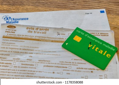 Paris, France - September 07, 2018 : French document of sick leave, stoppage of work and Vitale card