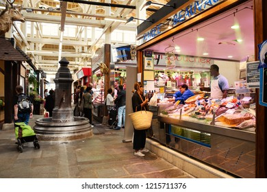 PARIS, FRANCE - SEPTEMBER 1, 2018:  Fish stall at Beauvau food covered market famous for its various deli shops and for its beautiful wooden interior and hall decoration.