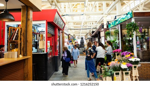 PARIS, FRANCE - SEPTEMBER 1, 2018:  Florist stall at Beauvau food covered market, famous for its various deli shops and for its beautiful wooden interior and hall decoration. Parisian everyday life.