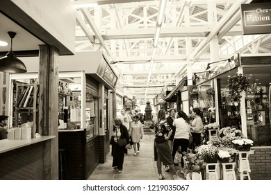 PARIS, FRANCE - SEPTEMBER 1, 2018:  Florist stall at Beauvau food covered market, famous for its various deli shops and for its beautiful wooden interior and hall decoration. Sepia photo.