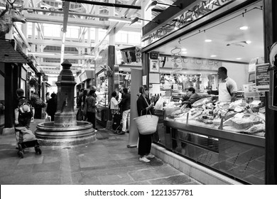 PARIS, FRANCE - SEPTEMBER 1, 2018:  Fish stall at Beauvau food covered market famous for its various deli shops and for its beautiful wooden interior and hall decoration. Black and white photo.