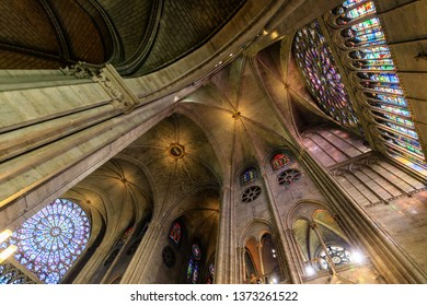 PARIS, FRANCE, SEPTEMBER 1, 2018 : View inside Notre Dame de Paris cathedrale structure with ancient stained windows