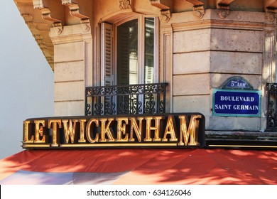 PARIS, FRANCE - SEPTEMBER 10, 2015: Letwickenham cafe building, front view and boulevard saint germain street sign