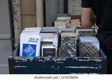 Paris, France - September 11, 2018: Used French books for stale at an outdoor bookstore on Rue de l'ecole in central Paris