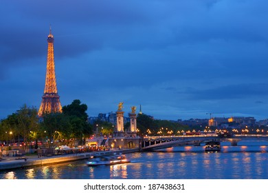 PARIS, FRANCE - SEPTEMBER 12, 2013: Trip boats on the Seine under the Pont Alexandre III in Paris. River cruises are the favorite leisure activity for thousands of tourists