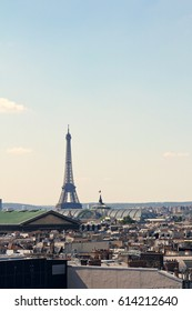 Paris / France - SEPTEMBER 12, 2014: Eiffel tower far in the background. Paris captured in a sunny day.
