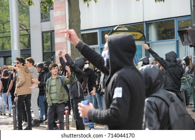 PARIS, FRANCE - SEPTEMBER 12, 2017 : breakers provocating the police during French strike and street protests against the overhaul of French labor laws