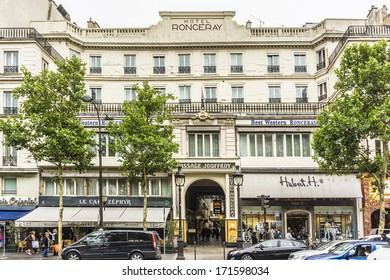 PARIS, FRANCE - SEPTEMBER 14, 2013: Passage Jouffroy (architects Francois Destailleur and Romain de Bourges, 1845) - shopping area with clothing stores, book stores, jewelers shops, confectionery.