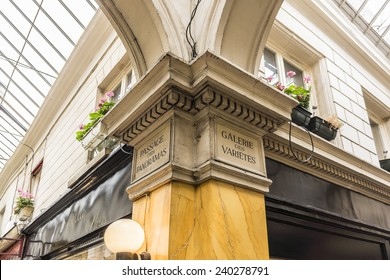 PARIS, FRANCE - SEPTEMBER 14, 2013: Interior of Passage Jouffroy (architects Francois Destailleur and Romain de Bourges, 1845) covered pedestrian walkway with shopping area.