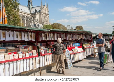 Paris, France - September 15, 2012: Books on display on a book stall in front of Notre Dame de Paris, left bank.