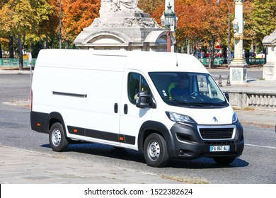 Paris, France - September 15, 2019: White cargo van Peugeot Boxer in the city street.