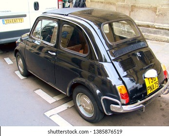 Paris, France - September 16, 2008: A Fiat 500 parked in the city of Paris. The Fiat 500 was a city car produced by the Italian manufacturer Fiat between 1957 and 1975.