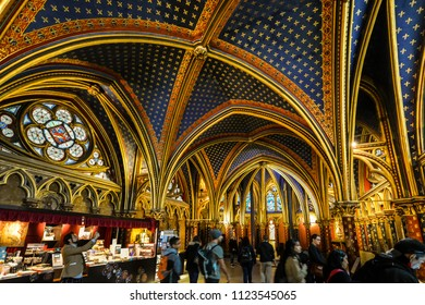 Paris, France - September 19 2017: Tourists sightsee and shop inside the ornate, gothic lower chapel of the Sainte Chapelle holy chapel in Paris France.