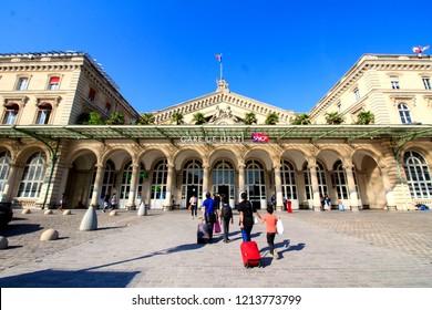 PARIS, FRANCE - SEPTEMBER 1st, 2018 : Family with suitcases is walking towards Gare de l'Est train station in Paris, France