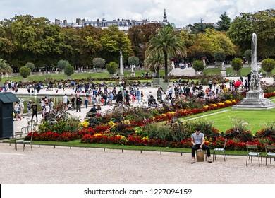 PARIS, FRANCE - SEPTEMBER 2, 2017: Tourists and Parisians relaxing in Luxembourg Garden (Jardin du Luxembourg). Jardin du Luxembourg - second largest Public Park in Paris.