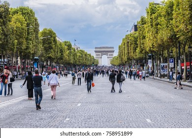 PARIS, FRANCE - SEPTEMBER 2, 2017: People walking on the Champs Elysees. Once a month, Champs-Elysees will be closed to traffic. Champs-Elysees - the most famous avenue of Paris has 1910m.