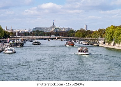Paris, France - September 20, 2018: Paris cityscape with view over Seine river, Passerelle Leopold-Sedar-Senghor and Grand Palais - Paris, France