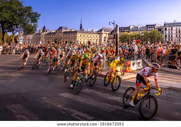 Paris, France - September 20, 2020: Yellow Jersey riding in front of the peloton on Pont Neuf bridge in Paris during the last stage of Le Tour de France 2020.