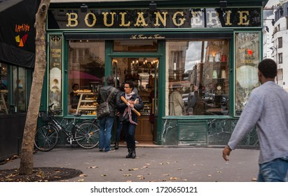 Paris, France - September 2013:Lunchtime queue for bread at a traditional boulangerie