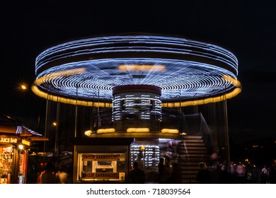 PARIS, FRANCE - September, 2015: Merry-Go-Round (carousel) illuminated against the background of night dark sky. Selective focus.