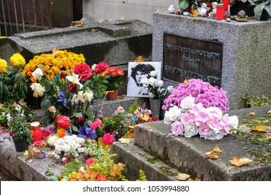 Paris, France - September 2017: Jim Morrison grave in Pere-Lachaise cemetery, Paris. Each year thousands fans and curious visitors come to pay homage to Jim Morrison's grave