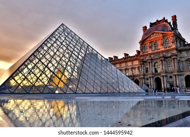 PARIS, FRANCE, September 2018, Louvre Museum. Sunset view of the main pyramid and Richelieu building. Long exposure photography.