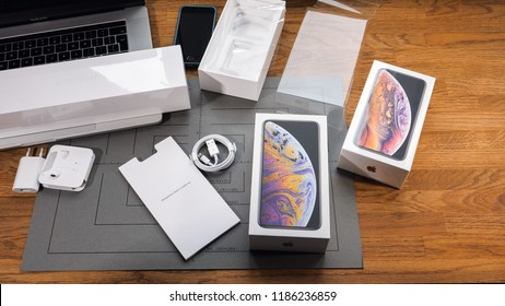 PARIS, FRANCE - SEPTEMBER 21, 2018: Unboxing latest new Apple Iphone Xs Max and Xs flagship smartphone mobile phone model from Apple Computers unboxed phone on table with all accessories