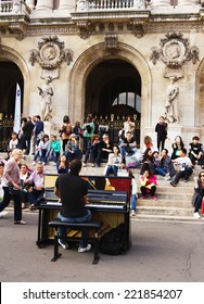 Paris, France -September 21,2014: Unidentified pianist play before public outdoors . Paris Opera