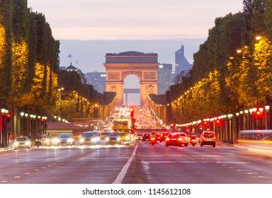 PARIS, FRANCE - SEPTEMBER 22 2011: car traffic at Champ D'Elysees boulevard in Paris city, France. night scene
