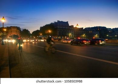 Paris, France - September 22, 2017: Walking through evening streets of Paris