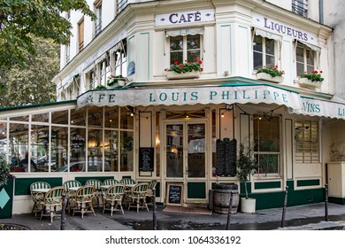 PARIS, FRANCE - SEPTEMBER 22, 2017: Street view of a typical outdoor coffee terrace