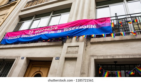 PARIS, FRANCE - SEPTEMBER 22, 2018: Lesbian, Gay, Bisexual and Transgender Community in Paris and Ile-de-France centre building with flags and banner on occasion of International day of Bisexuality.
