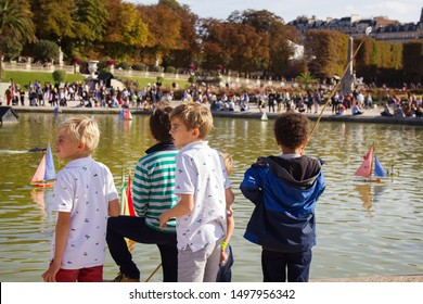 Paris, France - September 23, 2017: Children let boats in the pond. Luxembourg gardens, ponds and fountains