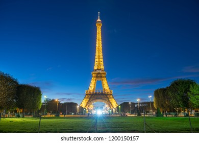 PARIS, France - SEPTEMBER 24, 2018 : the Illuminated Eiffel Tower on Park Champ de Mars at night in Paris, France