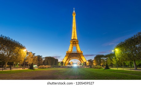 PARIS, France - SEPTEMBER 24, 2018 : Panorama of Illuminated Eiffel Tower on Park Champ de Mars at night in Paris, France