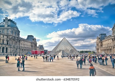 PARIS, FRANCE - SEPTEMBER 25, 2015: Louvre Museum the main building and the pyramid.  The Louvre is the biggest and most visited art museum in the world.
