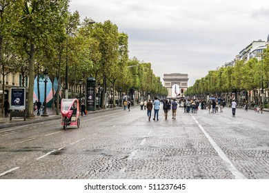 PARIS, FRANCE - SEPTEMBER 25, 2016: People enjoying a Car Free Day. People from Paris region and visitors will be able to enjoy a peaceful and breathable city with 648.15 kilometers of Car-Free Roads.