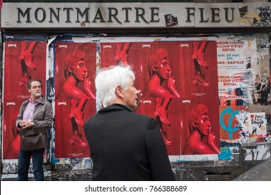 PARIS, FRANCE - September 25, 2017: The wall of a flower shop pasted with posters on Montmartre in Paris, France.