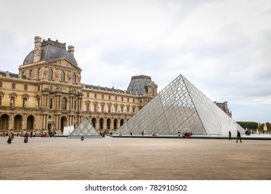 PARIS, FRANCE - SEPTEMBER 25, 2017: Facade of famous Louvre Museum in Paris City. Louvre Museum is the worlds largest art museum.