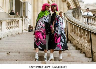PARIS, FRANCE - SEPTEMBER 25, 2019: Ami Suzuki and Aya Suzuki of Amiaya seen outside MAISON MARGIELA show, during Paris Fashion Week Womenswear Spring/Summer 2020.