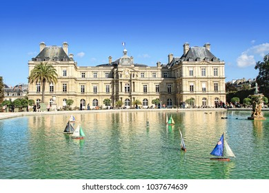PARIS, FRANCE - September 26, 2015: Children's ships in fountain near Luxembourg Palace - Luxembourg gardens and French Senate