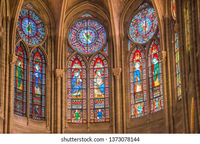 PARIS, FRANCE - SEPTEMBER 26, 2018 Beautiful vitrages stained glass windows in interior of cathedral Notre-Dame de Paris before fire April 15 2019. Paris, France