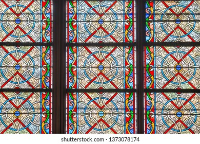 PARIS, FRANCE - SEPTEMBER 26, 2018 Beautiful vitrages stained glass windows of cathedral Notre-Dame de Paris before fire April 15, 2019. Paris, France